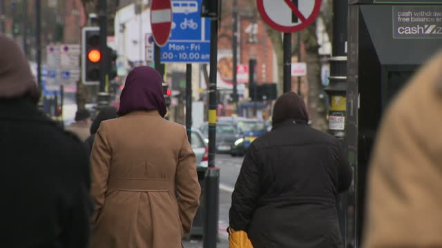 exterior shots of day-to-day life around sparkbrook, birmingham including muslim people walking, local shops and businesses and traffic on 5 march... - multiculturalism stock videos & royalty-free footage