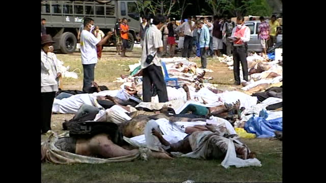 exterior shots of dead bodies and coffins laid out as locals and forensics workers look on and try to identify bodies>> on december 27 2004 in phuket... - indian ocean stock videos & royalty-free footage