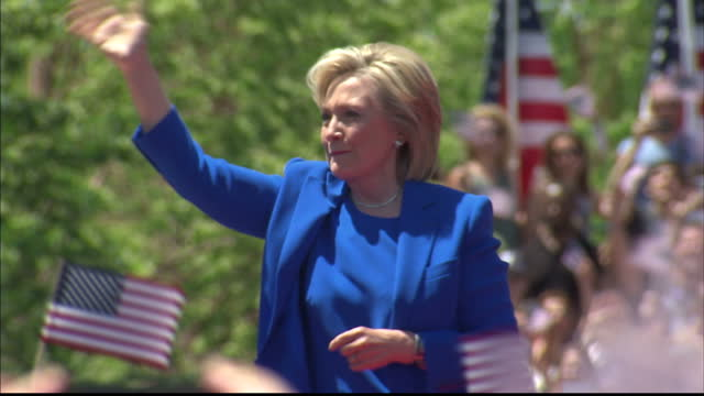 Exterior shots of democratic candidate Hillary Clinton walking up to podium at a rally in New York and speaking on April 14 2015 in Des Moines Iowa