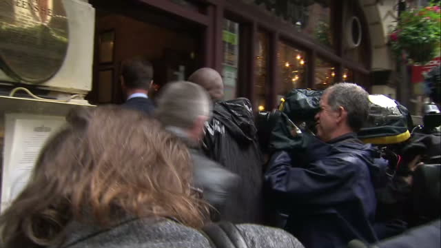 exterior shots of deputy prime minister nick clegg business secretary vince cable arrive together at a pub surrounded by press on june 03 2014 in... - british liberal democratic party stock videos and b-roll footage