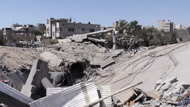 exterior shots of destroyed buildings and rubble in gaza in the aftermath of israeli missile strikes on july 26, 2014 in gaza city, gaza. - パレスチナ自治区点の映像素材/bロール