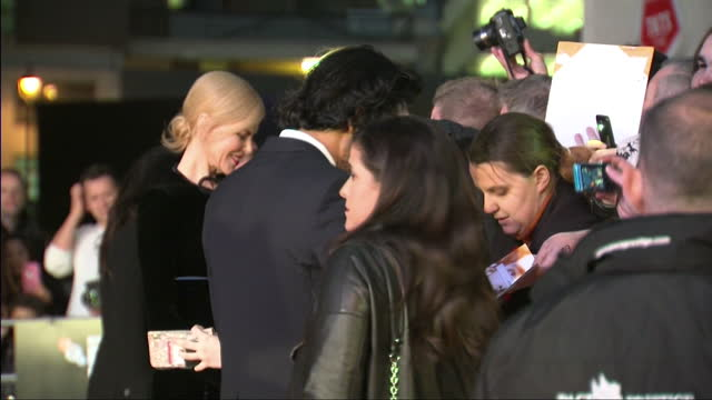 Exterior shots of Dev Patel and Nicole Kidman signing autographs and posing for pictures with fans during the UK premiere of 'Lion' at the BFI London...