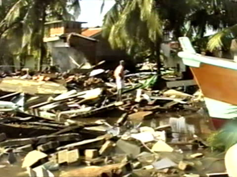 stockvideo's en b-roll-footage met exterior shots of devastated houses homes and buildings with flood water all around and woman crying over the fact she has lost everything. boxing... - 2004