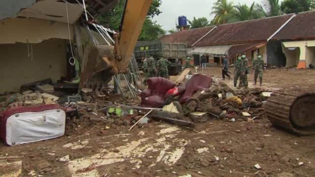 exterior shots of digger moving rubble of damaged buildings following the devastating tsunami few days before christmas on 25 december 2018 in carita... - moving after stock videos & royalty-free footage