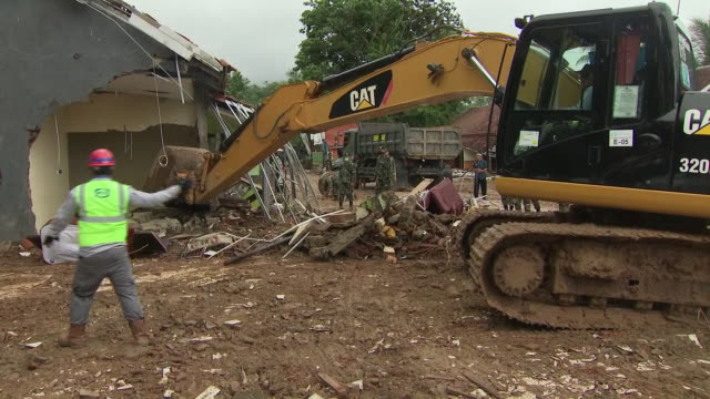 exterior shots of diggers and soldiers moving rubbles following the devastating tsunami on 25 december 2018 in carita banten province indonesia - moving after stock videos & royalty-free footage