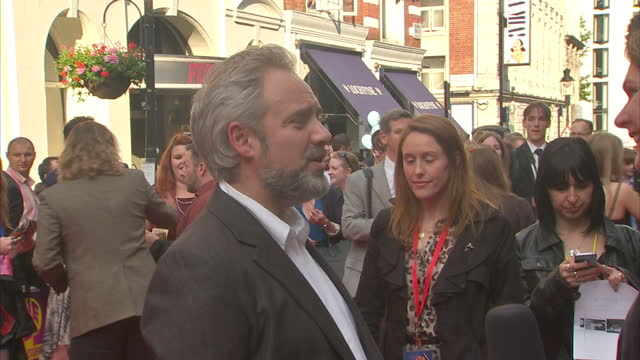 exterior shots of director sam mendes on the red carpet outside theatre royal drury lane being interviewed for his new musical charlie the chocolate... - sam mendes stock videos & royalty-free footage