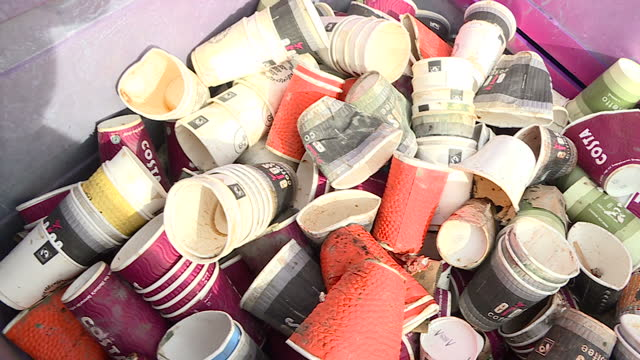 exterior shots of disposable coffee cup being sorted by hand in a recycling centre on march 30 2017 in london england researchers say charging for... - coffee cup stock videos & royalty-free footage