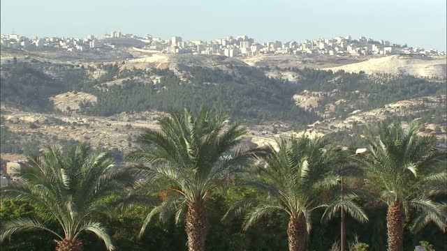 exterior shots of distant contested e1 area settlement buildings in the hills over east jerusalem on december 03 2012 in jerusalem israel - east jerusalem stock videos and b-roll footage