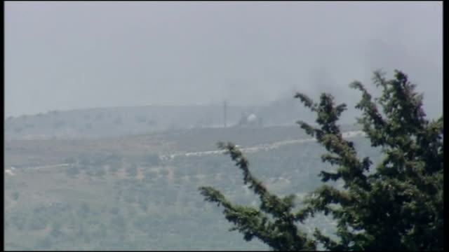 Exterior shots of distant smoke and explosions in Lebanon from the Israeli side of the border during the 2006 conflict between Israel and Hizbollah...