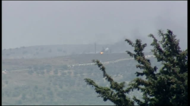 exterior shots of distant smoke and explosions in lebanon from the israeli side of the border during the 2006 conflict between israel and hizbollah... - 2006 stock videos & royalty-free footage