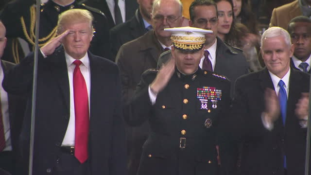 exterior shots of donald j trump watching a pre-inauguration parade on the white house lawn with his vice president elect mike pence on january 20,... - president stock videos & royalty-free footage