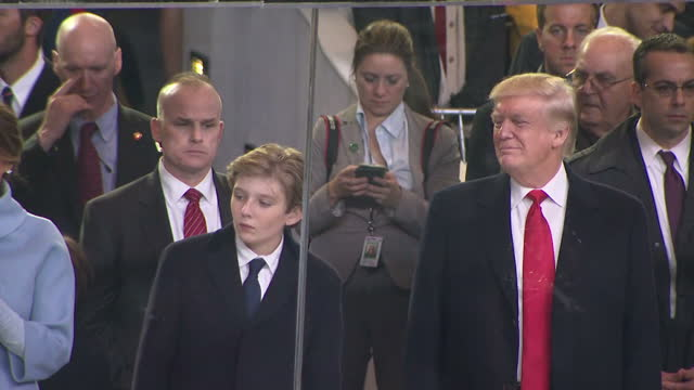 Exterior shots of Donald J Trump watching a preinauguration parade on the White House lawn with his Vice President Elect Mike Pence on January 20...