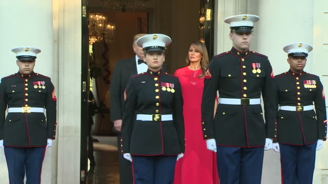 exterior shots of donald trump and wife melania trump waiting on the steps of winfield house for the arrival of prince charles and camilla, duchess... - 国賓訪問点の映像素材/bロール