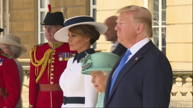 exterior shots of donald trump melania trump and the queen walking from the rear doors of buckingham palace and standing for a rendition of the star... - state visit stock videos & royalty-free footage