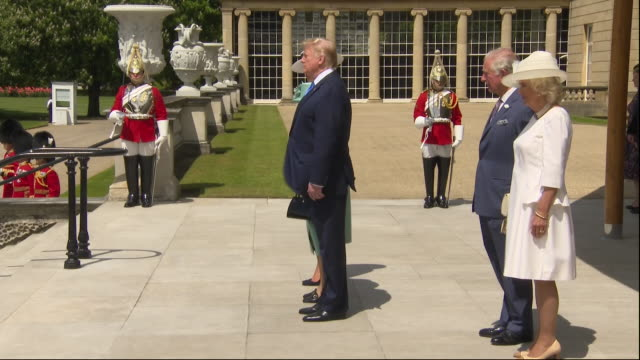 exterior shots of donald trump stood for a rendition of god save the queen on the steps of buckingham palace with the queen melania trump prince... - state visit stock videos & royalty-free footage
