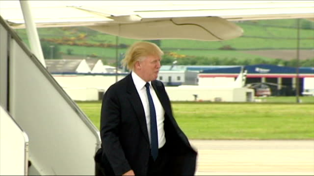 exterior shots of donald trump walking from his private boeing 727 plane to waiting car on november 01 2008 in balmedie scotland - president trump stock videos and b-roll footage