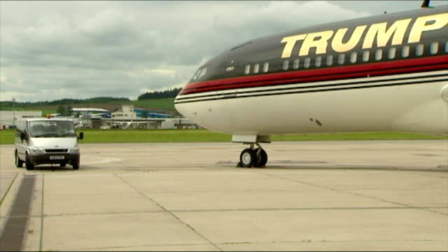 exterior shots of donald trump's converted boeing 727 private plane taxiing on arrival in scotland, with its distinctive trump lettering on november... - lifestyles stock videos & royalty-free footage