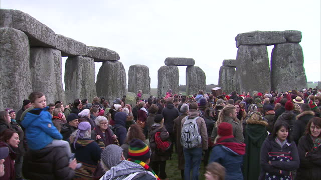 exterior shots of druids and pagans gathered among the stones of stonehenge to celebrate winter solstice on december 22 2015 in amesbury united... - paganism stock videos and b-roll footage