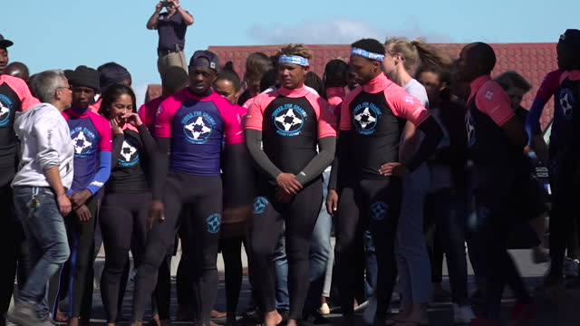exterior shots of duke and duchess of sussex dancing with ngo waves for change group at monwabisi beach on 24 september 2019 in cape town, south... - cape town stock videos & royalty-free footage