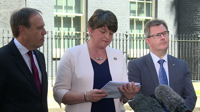 exterior shots of dup leader arlene foster addressing the media outside number 10 downing street, flanked by dup deputy leader nigel dodds and dup mp... - dup stock-videos und b-roll-filmmaterial