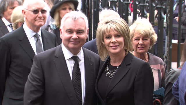 exterior shots of eamonn holmes ruth langford arriving together for a memorial service for sir terry wogan at westminster abbey on september 27 2016... - terry wogan video stock e b–roll