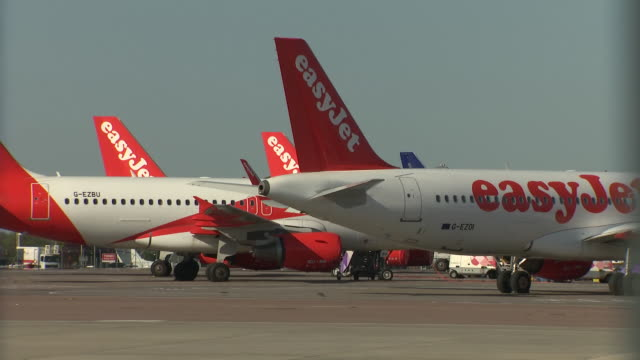 exterior shots of easy jet planes parked at luton airport during country lockdown on 20 april 2020 in luton, united kingdom - luton airport stock videos & royalty-free footage