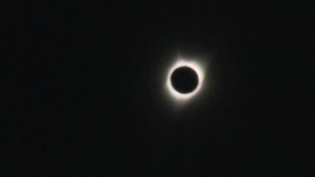 exterior shots of eclipse watchers viewing the total solar eclipse through special eclipse glasses including shots of the sun's corona shining from... - solar eclipse glasses stock videos and b-roll footage