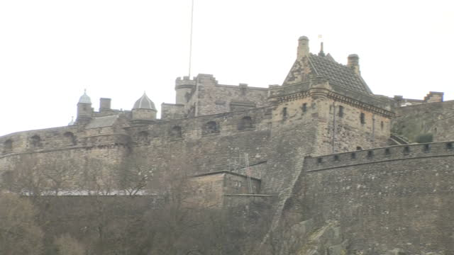 exterior shots of edinburgh castle as seen from princes street gardens including shots of the royal scots greys memorial on march 16 2017 in... - edinburgh castle stock videos & royalty-free footage