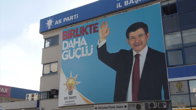 exterior shots of election billboards featuring ahmet davutoglu, turkish pm, and an ak party election office on october 10, 2015 in gaziantep, turkey. - primo ministro turco video stock e b–roll
