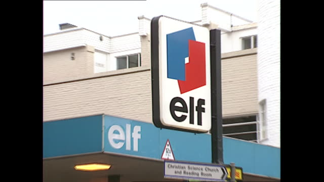 exterior shots of elf and total petrol stations with boards showing prices and cars passing on 10 september 1989 in london, united kingdom - petrol stock videos & royalty-free footage