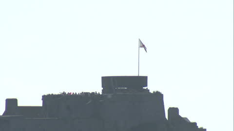 exterior shots of elizabeth castle on st helier and the sea and beach area on a sunny, clear day on september 16, 2014 in st helier, jersey. - channel islands england stock videos & royalty-free footage