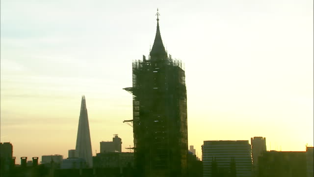 exterior shots of elizabeth tower at sunrise, covered in scaffolding, good for timelapse sequences, on 7 october 2020 in london, united kingdom - part of a series stock videos & royalty-free footage