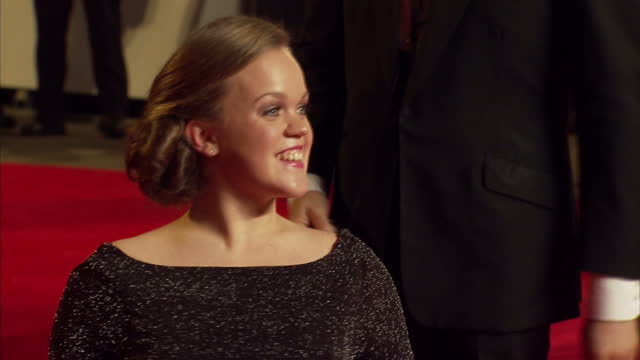 exterior shots of ellie simmonds double paralympic champion pose for photos on red carpet of skyfall film james bond skyfall world premiere on... - skyfall 2012 film stock videos and b-roll footage