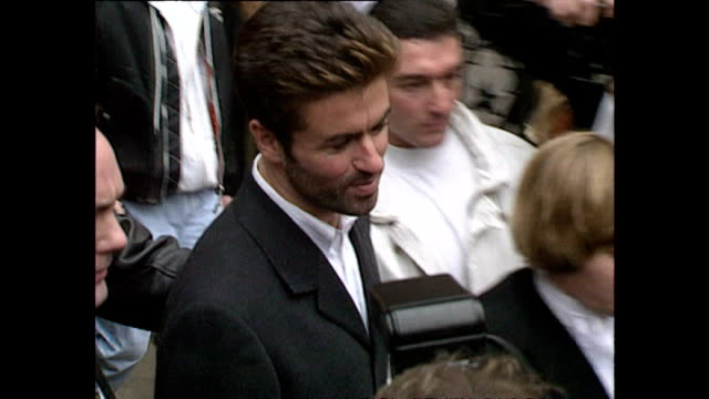 Exterior shots of Elton John departing the Royal Courts of justice followed by George Michael on November 01 1993 in London England