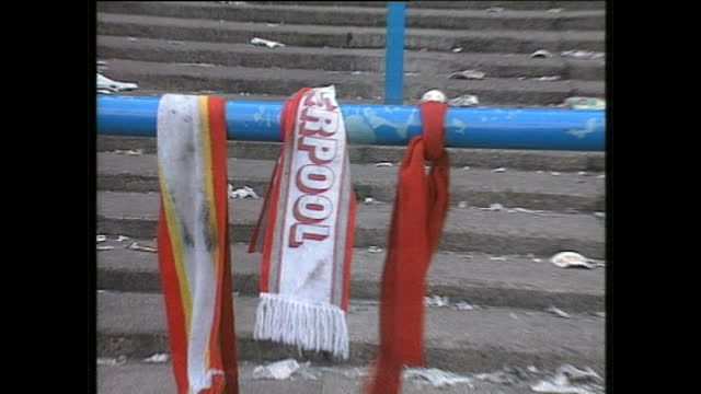 exterior shots of emergency crews investigating the aftermath of the hillsborough stadium disaster, liverpool fc scarves and damaged railings in the... - hillsborough stadium stock videos & royalty-free footage
