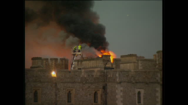 exterior shots of emergency fire crews putting out a fire at windsor castle on november 20 1992 in windsor england - windsor england stock videos and b-roll footage