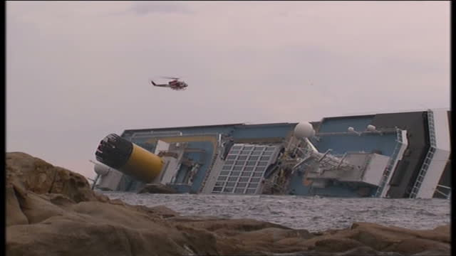 Exterior shots of emergency rescue workers being winched from Costa Concordia into rescue helicopter after searching for survivors Emergency rescue...