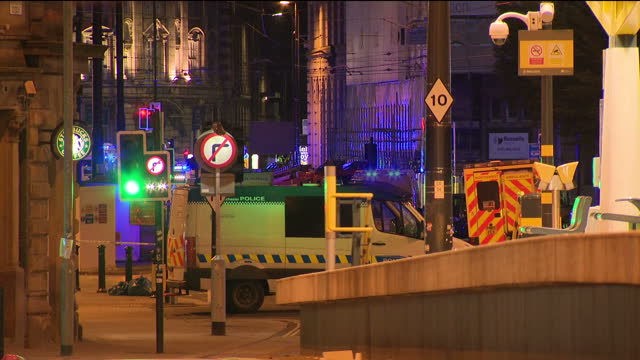 exterior shots of emergency services and cordoned off area outside the manchester arena after suicide bomber targeted an ariana grande concert on... - terrorism stock videos & royalty-free footage