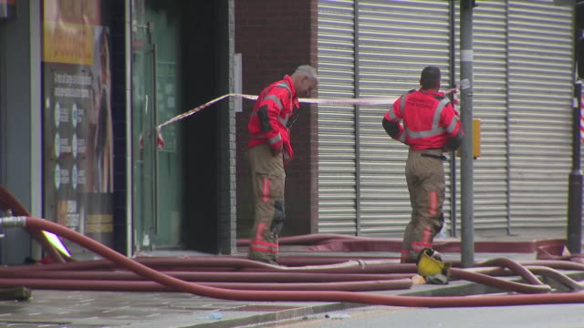 exterior shots of emergency services and firefighters at the student accommodation building where fire broke out on 16 november 2019 in bolton... - misfortune stock videos & royalty-free footage