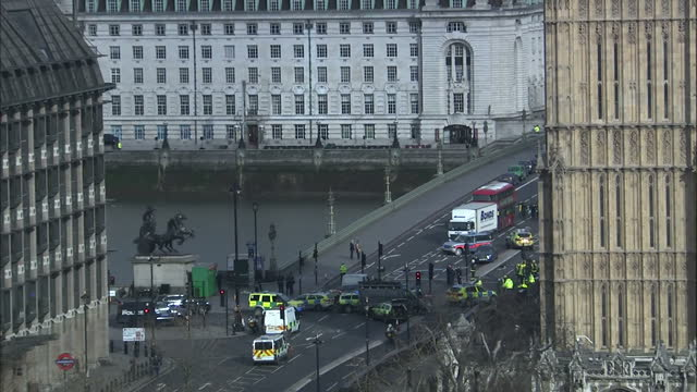 exterior shots of emergency services outside the houses of parliament and on westminster bridge in the aftermath of the terror attack on westminster... - westminster bridge stock-videos und b-roll-filmmaterial