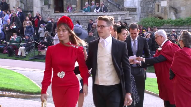exterior shots of emma louise connolly and oli proudlock arriving at st george's chapel for the wedding of jack brooksbank and princess eugenie on 12... - st. george's chapel stock videos & royalty-free footage