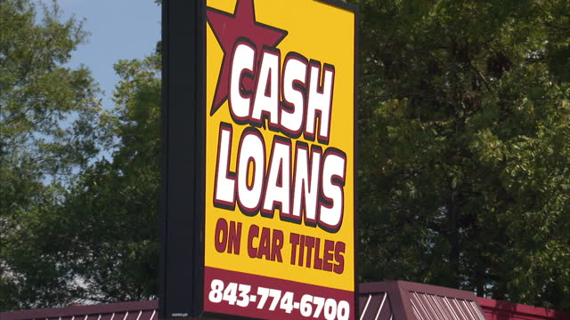 exterior shots of empty business units in dillon, sc and signs advertising cash loans, payday loans and the like on october 24, 2012 in dillon, south... - 貸し付け点の映像素材/bロール