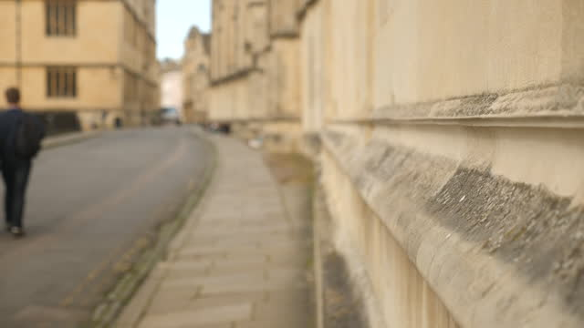 exterior shots of empty cobbled path in oxford, oxford university building the sheldonian theatre on 25th february 2021 in oxford, united kingdom. - person in education stock videos & royalty-free footage