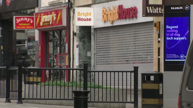 exterior shots of empty northampton town centre streets with shuttered closed shops and restaurants due to the coronavirus lockdown on 3 april 2020... - northampton stock-videos und b-roll-filmmaterial