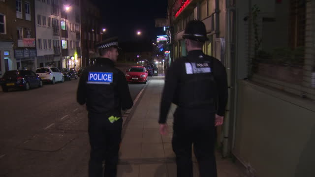 exterior shots of empty northampton town centre streets with police on patrol at night time enforcing the lockdown on 3 april 2020 in northampton,... - northampton stock-videos und b-roll-filmmaterial
