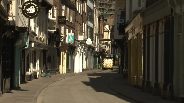 vidéos et rushes de exterior shots of empty streets and closed shops during the coronavirus epidemic and lockdown on 25th march 2020 york united kingdom - lockdown