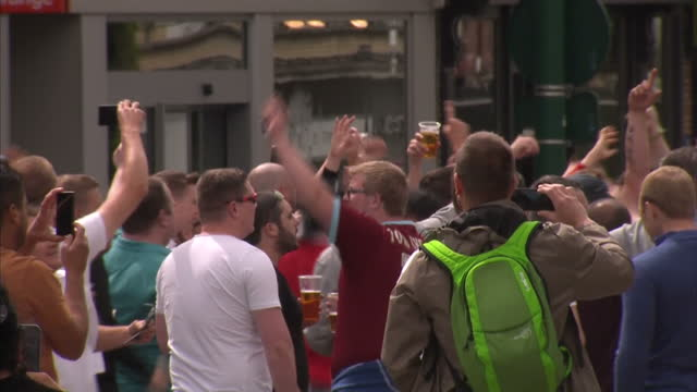 vídeos de stock, filmes e b-roll de exterior shots of england and wales football fans celebrating in lens before match against each other shots of police presence in the city on june 15... - euro 2016