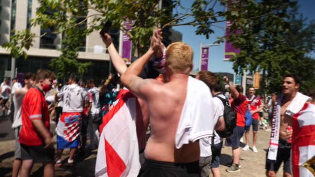 exterior shots of england footbal fans singing and waving flags outside wembley stadium before euro 2020 match against croatia on 13th june 2021... - fan enthusiast stock videos & royalty-free footage
