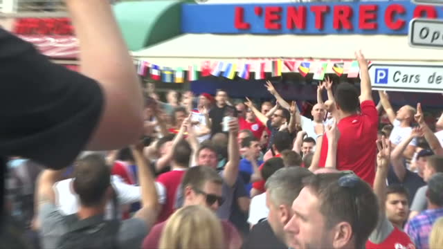 exterior shots of england football fans celebrating chanting in square on june 10 2016 in marseille france - hooligan stock videos & royalty-free footage