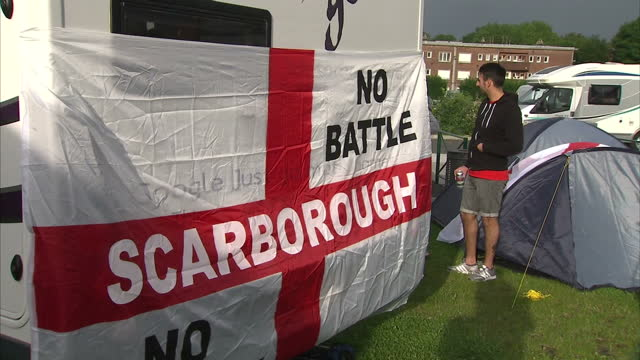exterior shots of england football fans partying in caravan park caravans with england football flags on them on june 15 2016 in lens france - euro 2016 stock videos and b-roll footage